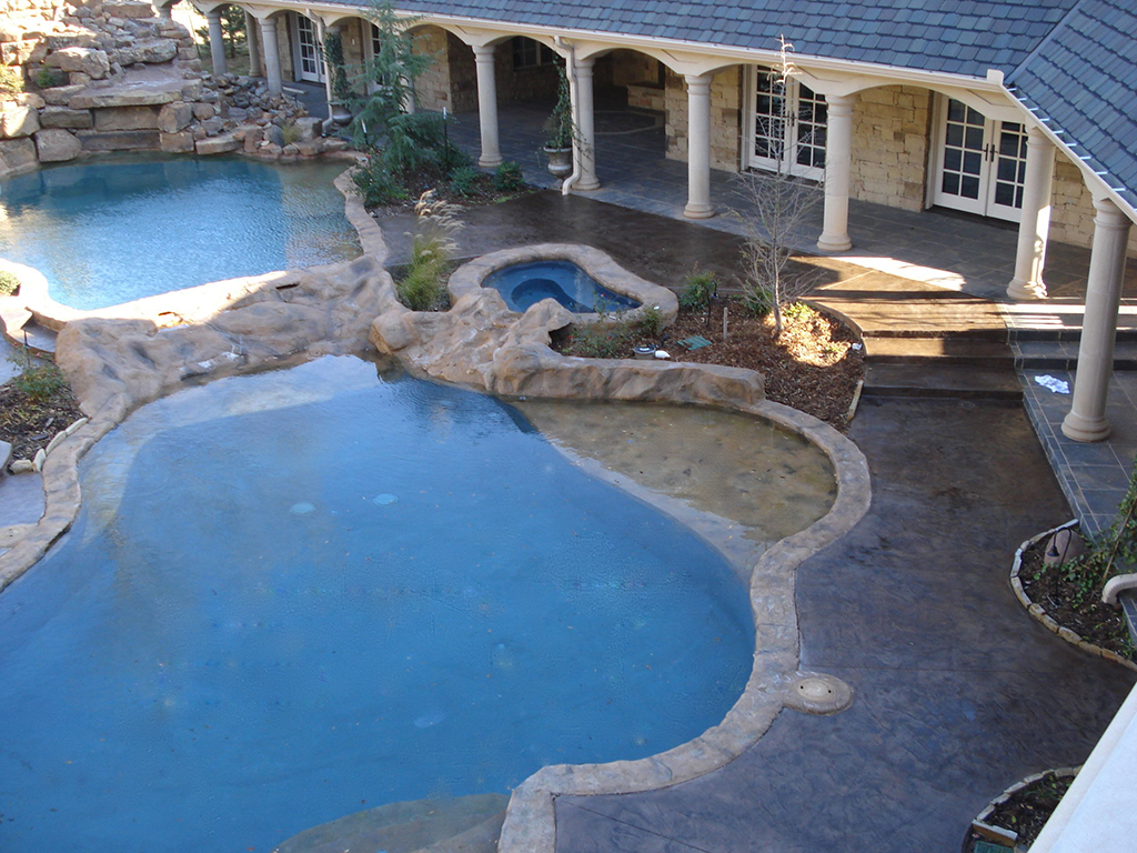 Moon decorative concrete stamped concrete deck around for Concrete pool designs